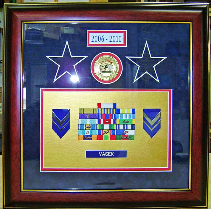 Framed Military coin bars and pins